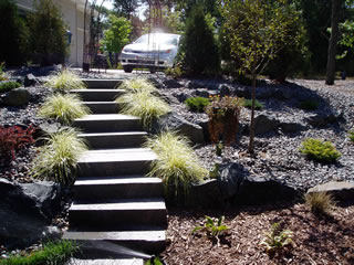 Stephan landscape services based in elk river mn can for Installing river rock landscaping